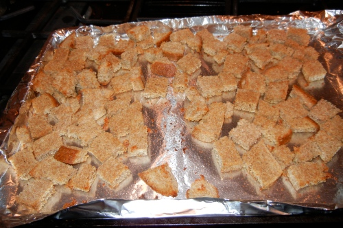 Preheat oven to 375. Cut the bread into ¾ inch cubes. Place bread ...